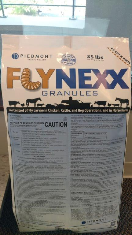 A bag of Flynexx granules is displayed in Piedmont's lobby. The product controls flies in swine, cattle and poultry operations.